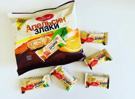 Конфеты на подложке из  шоколадной  глазури. 240 гр. Апельсин и злаки